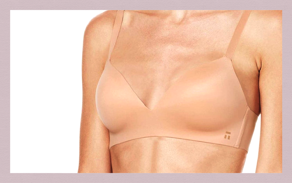 Closeup of a model wearing one of Tommy John's Second Skin bra representing one of the best bras for sleeping in
